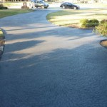 Classic texture with custom scoreline on residential driveway