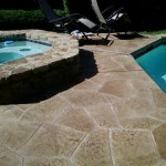Residential Pool Deck Resurfaced with a Stamped Overlay