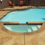 Stamped overlay on residential pool deck