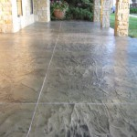 Tuscan covered concrete patio in scored tile pattern