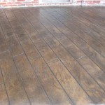 """Concrete patio covered with Tuscan in """"wood deck"""" pattern"""