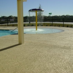 concrete resurfaced pool deck at neighborhood community pool