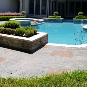 beautiful home pool deck after stain rehab