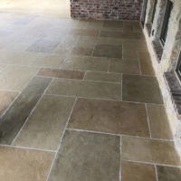 home porch restored with limestone overlay