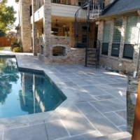 pool deck resurfaced using limestone overlays