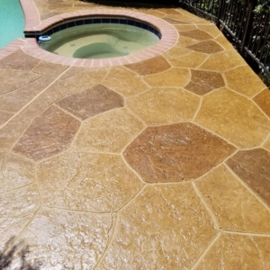 pool deck resurfaced with stamped overlay