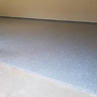 residential garage with epoxy flooring