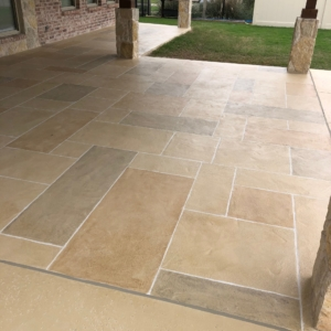 residential patio resurfaced with limestone overlay