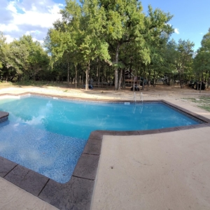 resurfaced pool deck with stamped concrete overlays