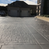 stain rehab process residential driveway