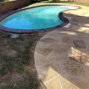 stamped overlay on concrete residential pool deck